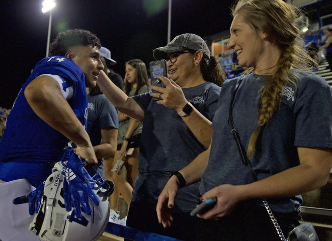 Tristan Franklin, far left, celebrates with fans after a Lake View win Thursday, September 12, 2019.
