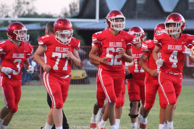 The Miles Bulldogs jog onto the field during their game against the Roscoe Plowboys on Friday, Sept. 13, 2019, at Gary Krejci Memorial Stadium in Miles.