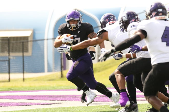 Gabriel Watson of USF attempts to get around several Winona State defenders during Saturday's game in Sioux Falls.