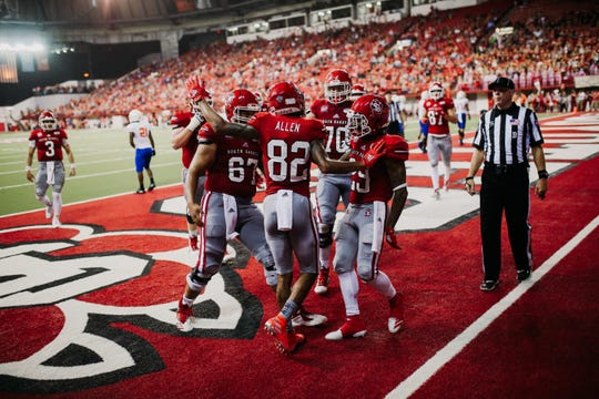 USD players celebrate a touchdown during Saturday's game against Houston Baptist in Vermillion.