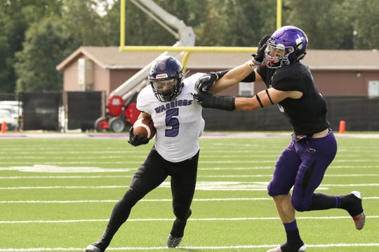 Jake Balliu of Winona State if forced out of bounds by Parker Gregston of USF during Saturday's game in Sioux Falls.