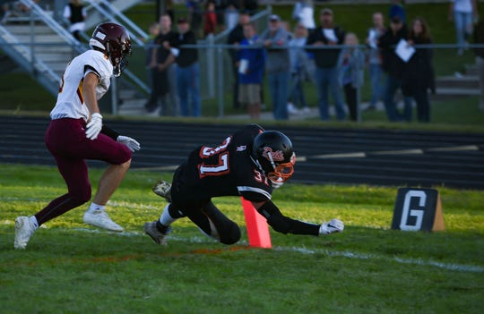 Dell Rapids Quarriers' Logan Stone dives into the end zone for a touchdown on Friday night, September 13, in Dell Rapids.