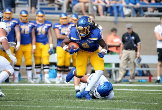 SDSU's CJ Wilson carries the ball Saturday in his team's win over Drake