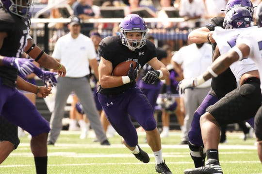 Thuro Reisdorfer of USF looks for running room during Saturday's game against Winona State at Bob Young Field in Sioux Falls.