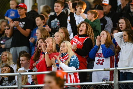 The Dell Rapids Quarriers student section cheers on Friday night, September 13, in Dell Rapids.