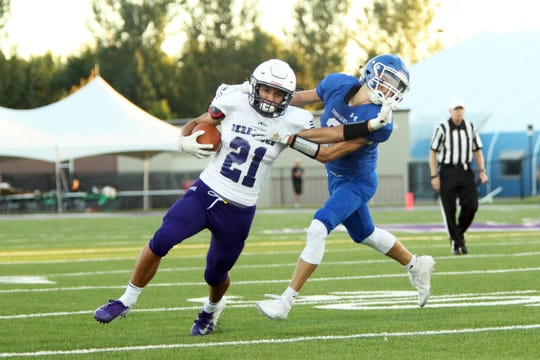 Noah Van Stedum of Sioux Falls Christian attempts to pull down Nate Kropuenske of Beresford on Friday night in Sioux Falls.