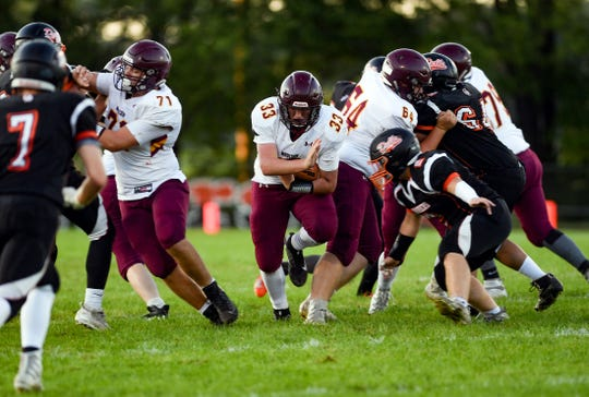 Trey Smith of the Madison Bulldogs pushes through the fray during a game against the Dell Rapids Quarriers on Friday night, September 13, in Dell Rapids.