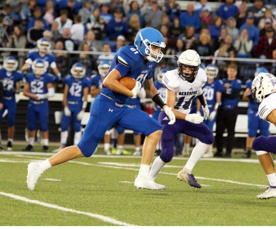 Zach Witte of Sioux Falls Christian runs the ball after a reception as Will Kuiper of Beresford defends on Friday night in Sioux Falls.