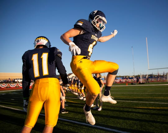Tea Area wide receiver and defensive back Joe Walnofer (4) jumps in the air before the game at Tea on Friday, Sept. 13, 2019.