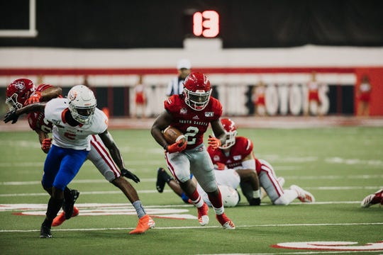 USD running back Kai Henry runs downfield against Houston Baptist on Saturday in Vermillion.