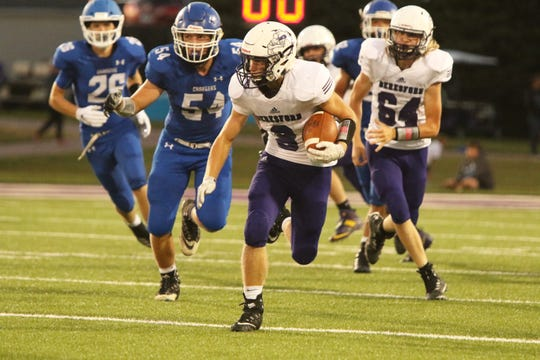 Payton Borah of Beresford sprints upfield with a reception as Evan Aasen of Sioux Falls Christian pursues on Friday night in Sioux Falls.