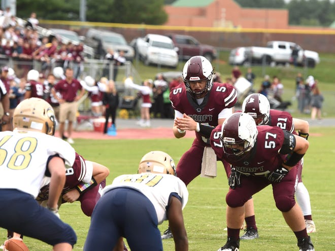 Stuarts Draft quarterback Henry Cooke (5) gets ready to take the snap in Friday night's win over Covington.