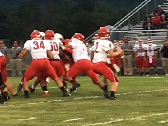 Riverheads' Bennett Dunlap sits in the pocket before throwing a 56-yard touchdown pass to Braeson Fulton.