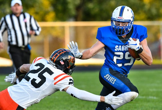 Sartell's Ethan Torgrimson rushes with the ball during the first half of the Friday, Sept. 13, game in Sartell.