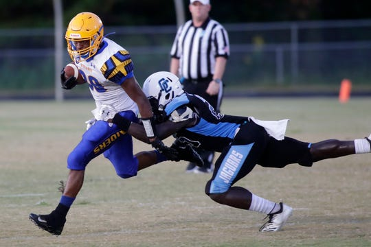 Rickards running back Devin Bailey looks to break free from a Gadsden County defender during a high school football game Friday, Sept. 13, 2019.