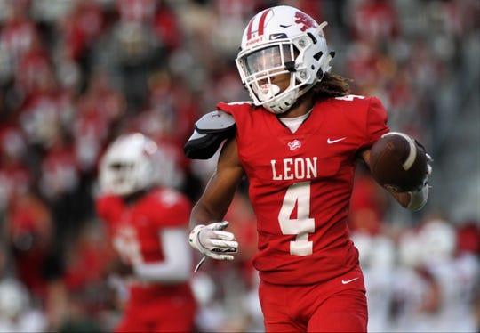 Leon junior cornerback Jarvis Williams celebrates an interception as Leon beat Tate 31-16 at Gene Cox Stadium on Friday, Sept. 13, 2019.