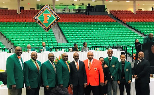 "From left to right: Douglas Cook, Dr. Irvin Clark, Col. Gregory Clark, Tony Bell, FAMU President Dr. Larry Robinson, Rattler ""F"" Club Executive Director Curtis Taylor, Madrick Quarles (niece of Ann O'Neal), Salif Kante, Jasmine Grice and Donnie Johnson, Jr. (son of Donnie Johnson) pose for a group photo during the FAMU Sports Hall of Fame enshrinement ceremony on Friday, Sept. 13, 2019."