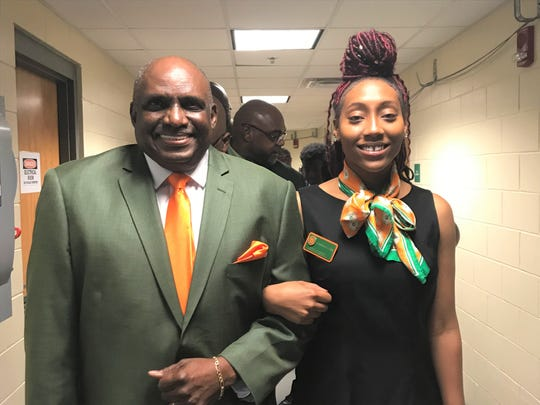 FAMU Baseball Alumni Association president Tony Bell was escorted by Dominique Alexis to his table during the FAMU Sports Hall of Fame enshrinement ceremony on Friday, Sept. 14, 2019.