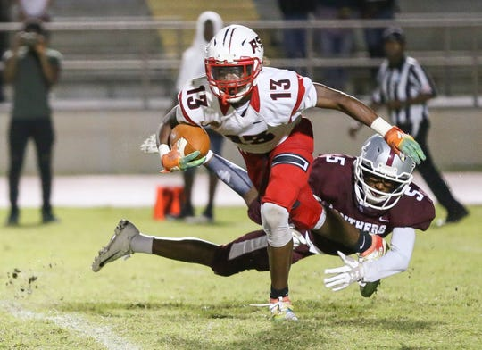 Port St. Lucie's James Monds (13) gets away from Fort Pierce Westwood's Triston Gardner (5) in the second quarter during a high school football game at Lawnwood Stadium on Friday, Sept. 13, 2019, in Fort Pierce.