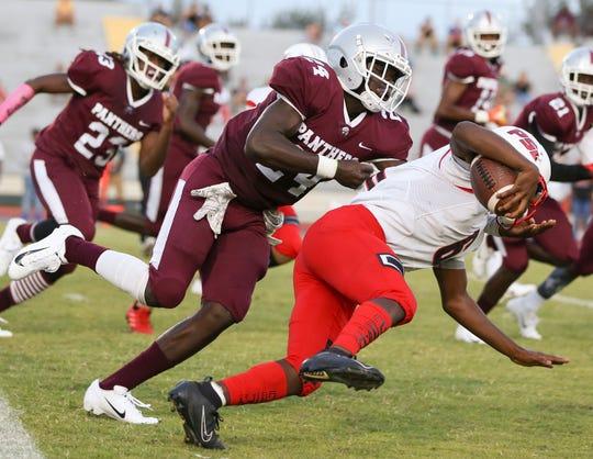 Fort Pierce Westwood's Kamari Wilson (24) tackles Port St. LucieÕs Saleem Felder (6) in the first quarter during a high school football game at Lawnwood Stadium on Friday, Sept. 13, 2019, in Fort Pierce.