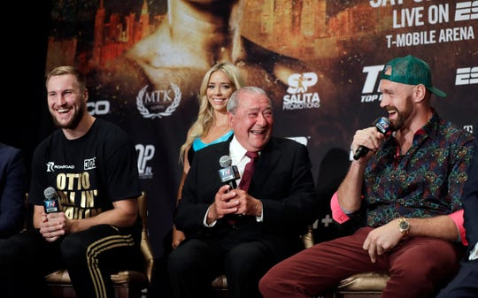 Otto Wallin, of Sweden, left, promoter Bob Arum and Tyson Fury, right, laugh during a news conference Wednesday, Sept. 11, 2019, in Las Vegas. Wallin and Fury will face each other in a heavyweight boxing match Saturday.