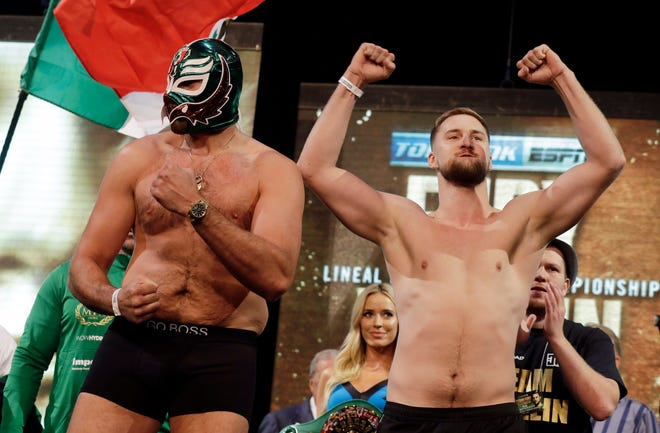 Tyson Fury, left, of England, and Otto Wallin, of Sweden, pose during a ceremonial weigh-in for their upcoming fight Friday, Sept. 13, 2019, in Las Vegas. Wallin and Fury will face each other in a heavyweight boxing match Saturday.