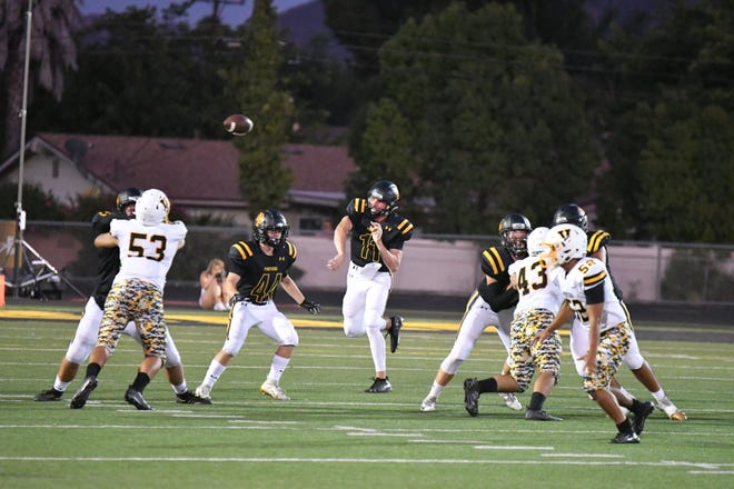 Newbury Park High quarterback Ben Gulbranson fires a pass during the Panthers' 35-34 win over Ventura High on Friday night.