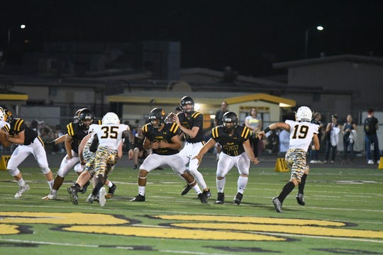Newbury Park High quarterback Ben Gulbranson surveys the field during the Panthers' 35-34 win over visiting Ventura High on Friday night.