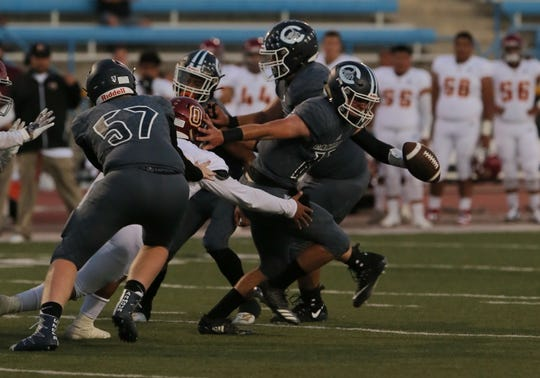 Quarterback James McNamara breaks free from a tackle during the Scorpions' victory over Oxnard. Camarillo, ranked No. 3 in The Star's poll, routed Rio Mesa on Friday night to move to 6-0.