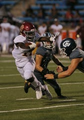 Xavier Harris, shown during last week's loss to Camarillo, had 267 yards from scrimmage and five touchdowns to lead Oxnard to a 50-28 win over Chaminade.