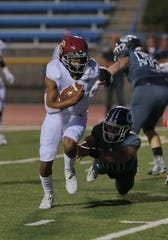 Jaden Jones, shown in a game against Camarillo, led Oxnard to a 33-14 win over Ventura in a Pacific View League opener.