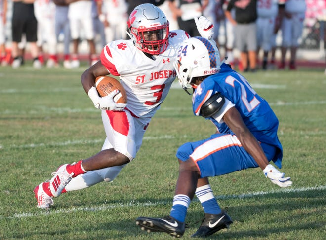 St. Joseph's Jada Byers runs the ball past Millville's Deandre Harris as Byers scores a touchdown during the 1st quarter of the football game played in Millville on Friday, September 13, 2019.
