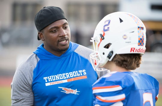 Millville High School football coach Dennis Thomas talks to Millville's Nathan Robbins prior to the football game between Millville and St. Joseph played in Millville on Friday, September 13, 2019.