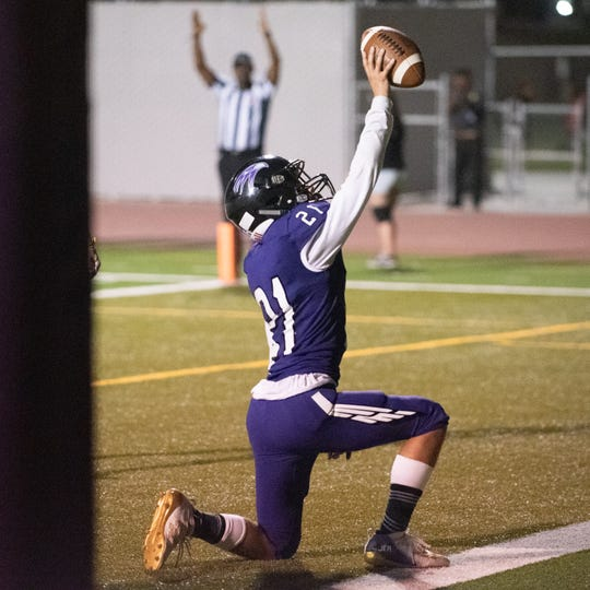 Mission Oak's Jericho Sierra celebrate one of his several touchdowns against Mt. Whitney in a non-league football game on Friday, Sept. 13, 2019.
