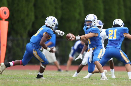 Ardsley quarterback Luke Mantini (4) hands off to Jalen Osborne (6) during their  42-6 win over Pearl River at Ardsley High School on Saturday, September 14, 2019.