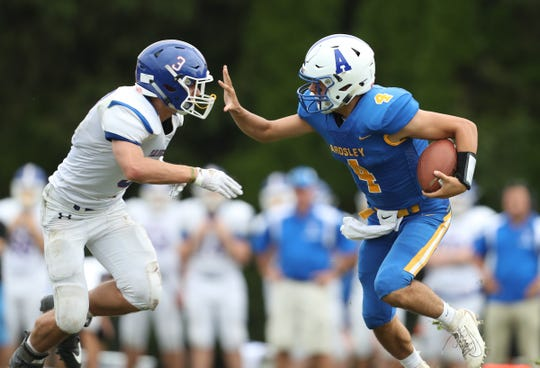 Ardsley quartrerback Luke Mantini (4) fends off a tackle by Pearl River's Liam Fitzpatrick (3) during their 42-6 win over Pearl River at Ardsley High School on Saturday, September 14, 2019.