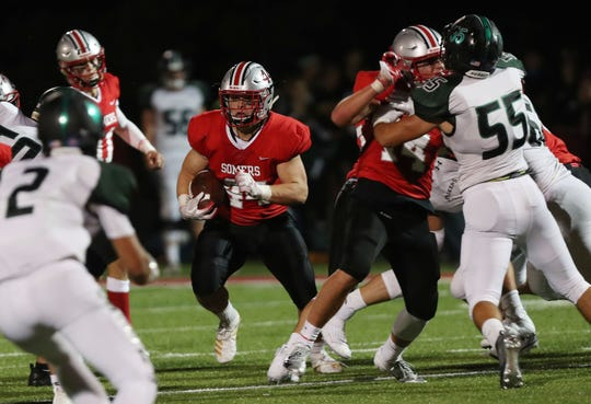 Somers Jack Kaiser (44) looks fro some running room in the Yorktown defense during football action at Somers High School Sept. 13, 2019.