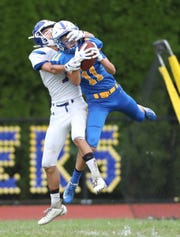 Ardsley's Tucker Peterson (11) pulls in an interception during their 42-6 win over Pearl River at Ardsley High School on Saturday, September 14, 2019.