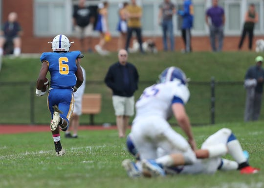 Ardsley's Jalen Osborne (6) runs up the sideline for a touchdown during their 42-6 win over Pearl River at Ardsley High School on Saturday, September 14, 2019.
