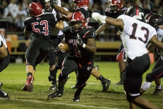 Red Lion's (4) looks for space to run Friday night against St. Andrew's. Red Lion defeated St. Andrew's 32-6.