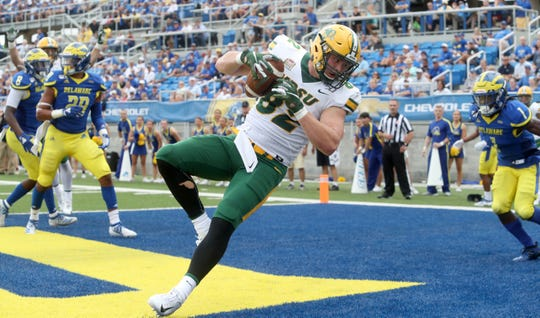North Dakota State tight end Ben Ellefson falls into the end zone with touchdown reception in the second quarter at Delaware Stadium Saturday.