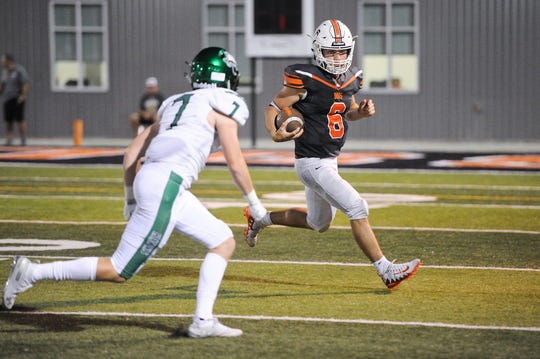 Mason Duke runs the ball out of bounds for Burkburnett as they face rival school Iowa park at home.