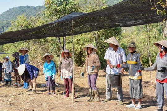 Vieng Xay villagers work in a bucket line during a recovery mission led by Defense POW/MIA Accounting Agency (DPAA) in Lao.