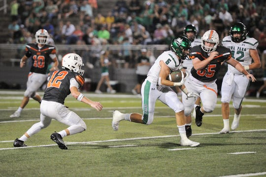 Jaydon Southard rushes the ball for Iowa Park in their 40-22 victory.