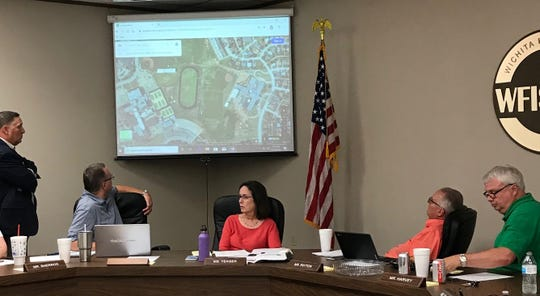 Wichita Falls ISD Superintendent Michael Kuhrt, standing, and school officials including WFISD Board President Elizabeth Yeager, center, discuss plans for schools at a work session Thursday.