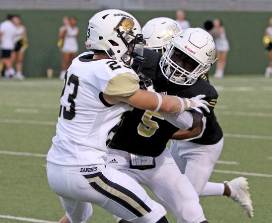 Rider's Mason Conner blocks Amarillo High's Trey Thomas Friday, Sept. 13, 2019, at Memorial Stadium. Rider defeated the Sandies 38-24.