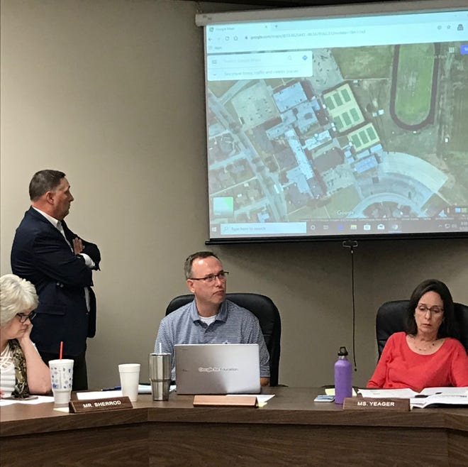Wichita Falls ISD Superintendent Michael Kuhrt, standing, and school officials including WFISD Board President Elizabeth Yeager, far right, discuss plans for schools at a Sept. 12 work session.