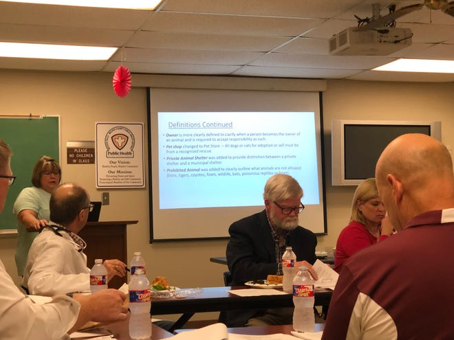 Public Health District Director Lou Kreidler explains some revisions to a city code of ordinances concerning animals.
