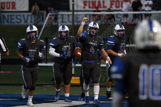 Zanesville's Ben Everson pumps his fist after throwing a touchdown pass against Tri-Valley.