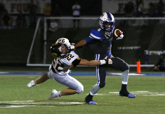 Zanesville's Jeremiah Norman pushes away Tri-Valley's Blake Sands during their Week 3 game at John D. Sulsberger Memorial Stadium. Norman leads a Blue Devil offense that hasn't scored less than 34 points in a game to date.